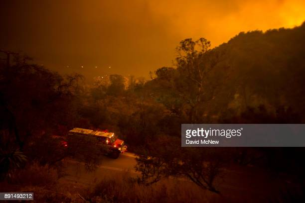 The Thomas Fire feeding on thick chaparral brush which hasnÕt burned in generations approaches homes on December 12 2017 in Montecito California The...