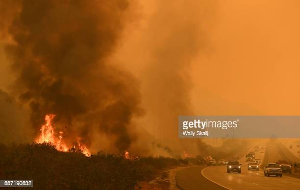 The Thomas Fire reaches the Northbound 101 freeway in Ventura Wednesday morning just across the freeway from the Pacific ocean on December 6, 2017 in...