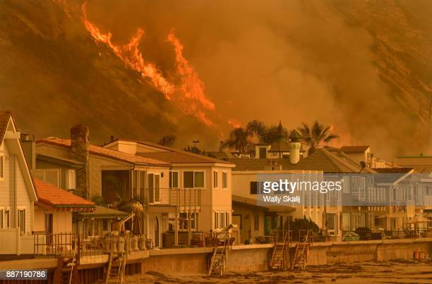 The Thomas Fire reaches the Northbound 101 freeway north of Ventura Wednesday threatening beachfront homes on December 6 2017 in Ventura California