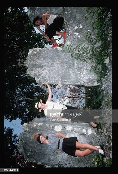 The Thompson Twins Alannah Currie Tom Bailey and Joe Leeway pose among large rocks