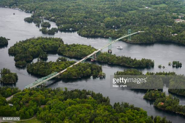 the thousand islands bridge connecting us and canada - ontario canada stock pictures, royalty-free photos & images