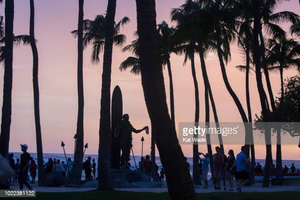 2018 The threat of Hurricane Lane does not deter the tourists and locals from watching the sunset from the beach near the Duke Kahanamoku as...