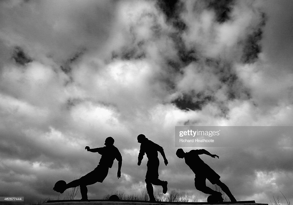 The three ages of Sir Stanley Matthews statue is seen prior to the Barclays Premier League match between Stoke City and Queens Park Rangers at Britannia Stadium on January 31, 2015 in Stoke on Trent, England.