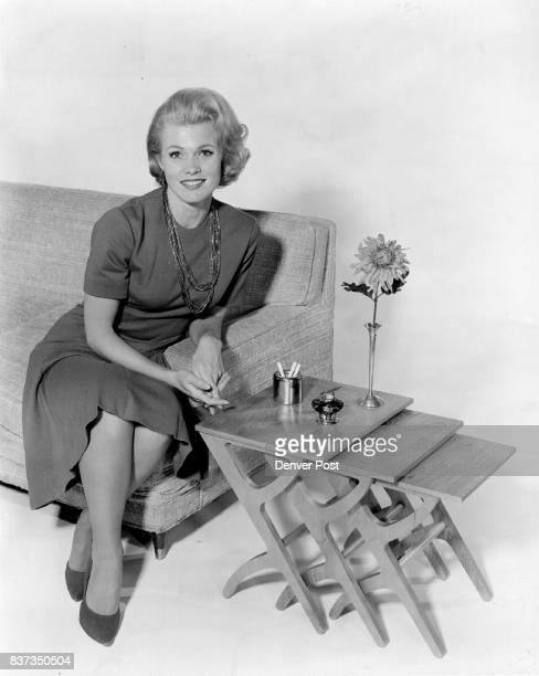 The three allpurpose nesting tables shown here with NBC's Pat Priest of the Bob Hope television show make ' an excellent substitute for spidery TV...