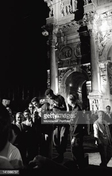 The three athletes winners of the marathon celebrating under the Arch of Constantine. Ethiopian athlete Abebe Bikila shows the gold medal, Moroccan...