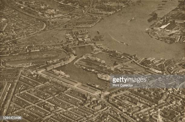The Three Basins of the East India Docks and the Blackwall Reach of the Thames Seen From The Air' circa 1935 Aerial view of the River Thames and...
