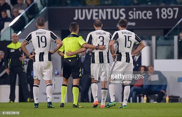 The three central defenders of Juventus FC Leonardo Bonucci Giorgio Chiellini and Andrea Barzagli and the referee Gianluca Rocchi speak during the...