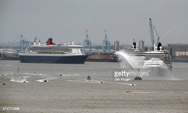 The three Cunard Queens Queen Mary 2 Queen Victoria and Queen Elizabeth meet on the River Mersey for the first time on May 25 2015 in Liverpool...