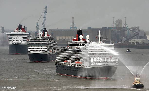 The three Cunard Queens seen Queen Mary 2 Queen Victoria and Queen Elizabeth meet on the River Mersey for the first time on May 25 2015 in Liverpool...