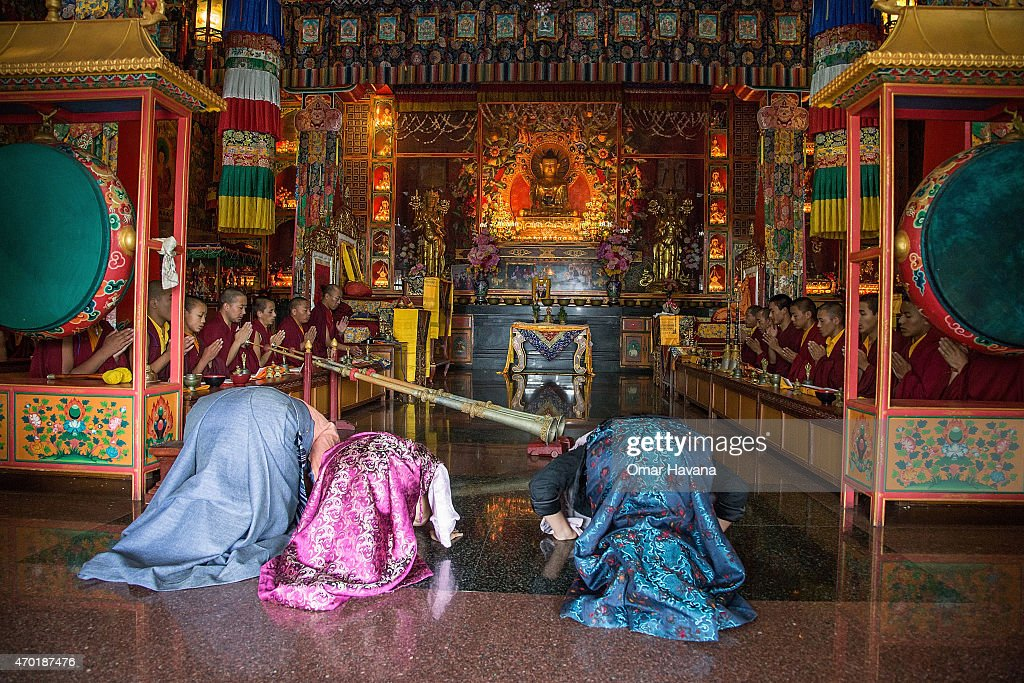The three daughters of Ang Kaji Sherpa, one of the 16 sherpas who died in the Everest Avalanche one year ago, pray during a memorial organised in the Lhundrup Choeling monastery for the memory of their father on April 18, 2015 in Kathmandu, Nepal. Friends and family of the 16 Sherpas who lost their lives one year ago in an avalanche on Mt. Everest gathered on today for a tribute in memory of those lost. On the morning of 18 April 2014, an avalanche killed the 16 Sherpas who were carrying gear up the mountain and led to growing demands for better pay and death and injury benefit payouts to the families of Sherpas.