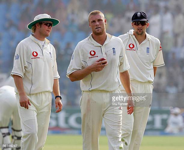 The Three England fast bowlers for this Test Matthew Hoggard Andrew Flintoff and Steve Harmison stand in the field during the first day of the First...