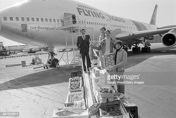The three founders of Flying Foods Andrew Udelson Walter Martin and Paul Moriates with an unidentified man in a suit pose on the tarmac at La Guardia...
