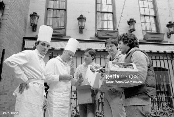 The three founders of Flying Foods Andrew Udelson Walter Martin and Paul Moriates deliver their produce to chefs in front of the Lutece restaurant...