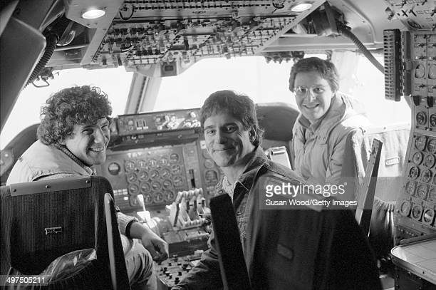 The three founders of Flying Foods Andrew Udelson Walter Martin and Paul Moriates pose in the cockpit of an air freight plane on the tarmac at La...