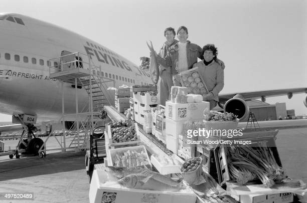 The three founders of Flying Foods Andrew Udelson Walter Martin and Paul Moriates pose on the tarmac at La Guardia airport beside an air freight...