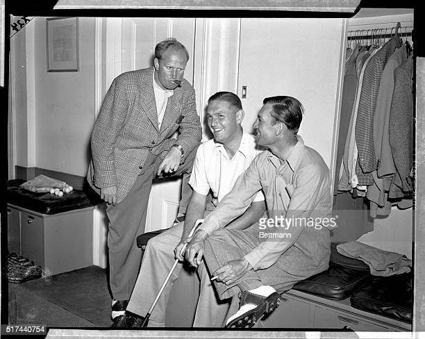 The three golfers who have a chance to overtake pacesetting Herman Kaiser in the Augusta Masters are shown talking it over after the third round...