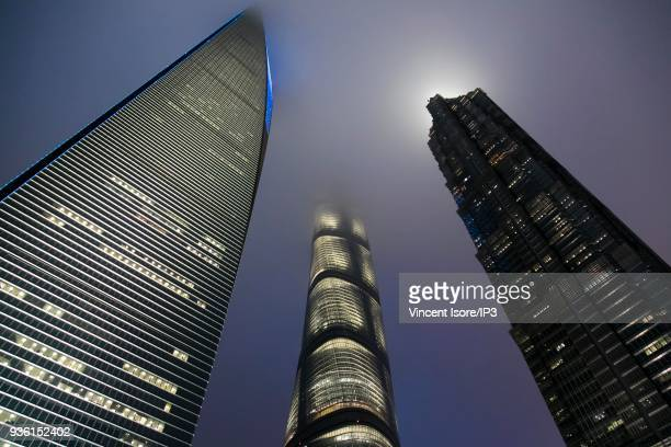 The three highest skyscrapers in the business district with their heads in the clouds the Shanghai World Financial Center with 492 meters the...
