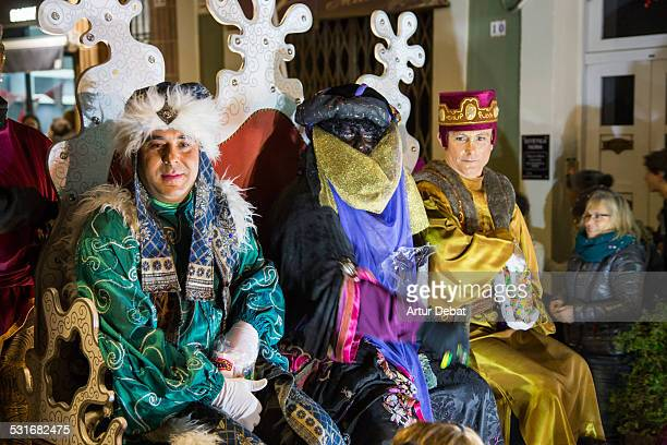 The Three Kings parade arriving at town with all kids waiting for the candy and give him the letters January 5th of 2015 in Barcelona Catalonia Europe