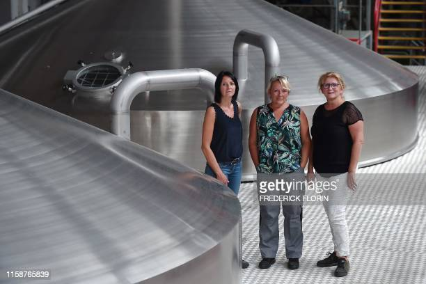 The three master brewers of the Kronenbourg beer brewery Celine Chauvin Schera Laurence Gutfreund and Sylvie Lienhart pose during a photo session in...