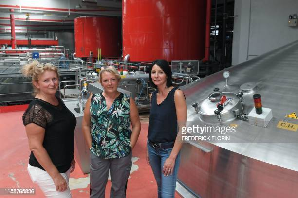 The three master brewers of the Kronenbourg beer brewery Sylvie Lienhart Laurence Gutfreund and Celine Chauvin pose during a photo session in the...