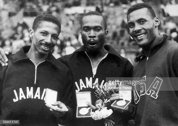 The three Olympic medalists of the 400m of the Games in Helsinki posed with their medals on July 28 1952 From left to right the Jamaicain Herbert...