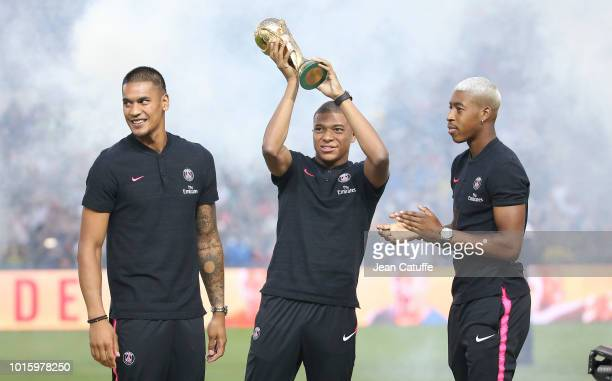 The three Parisians World Champions in Russia goalkeeper Alphonse Areola Kylian Mbappe holding the World Cup trophy Presnel Kimpembe are feted by...