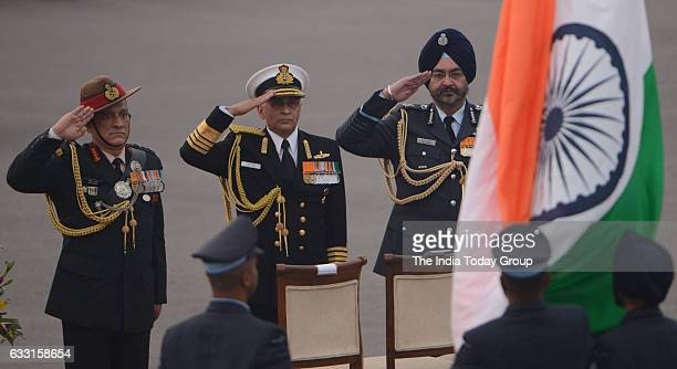 The three services chiefs Army Chief General Bipin Rawat Naval Chief Admiral Sunil Lanba and Airforce Chief Marshal Birender Singh Dhanoa saluting...