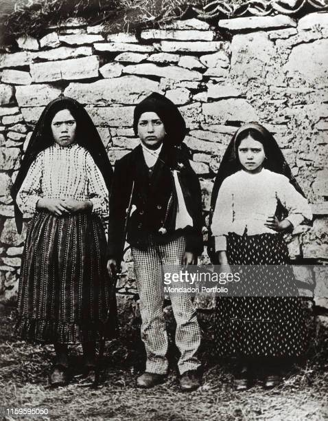The three shepherd children Francisco Marto, Lucia dos Santos and Jacinta Marto where the Virgin appeared to them. Fatima, Portugal. 1917