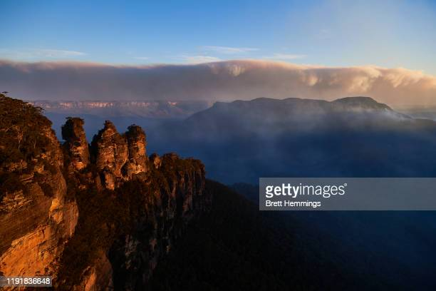 The Three Sisters are pictured as smoke from scattered bushfires covers the horizon on December 04, 2019 in Katoomba, Australia. It is estimated that...