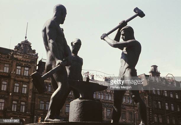 The Three Smiths Statue in Three Smiths Square in Helsinki Finland circa 1965 Unveiled in 1932 it is the work of sculptor Felix Nylund and depicts...