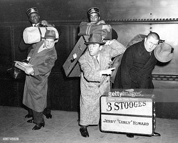 Larry Fine Moe Howard and Jerry 'Curly' Howard arrive at Penn Station