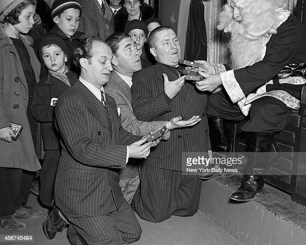 The Three Stooges who won stage fame with Ted Healy who died mysteriously yesterday make a grim demand on department store Santa The Three Stooges...