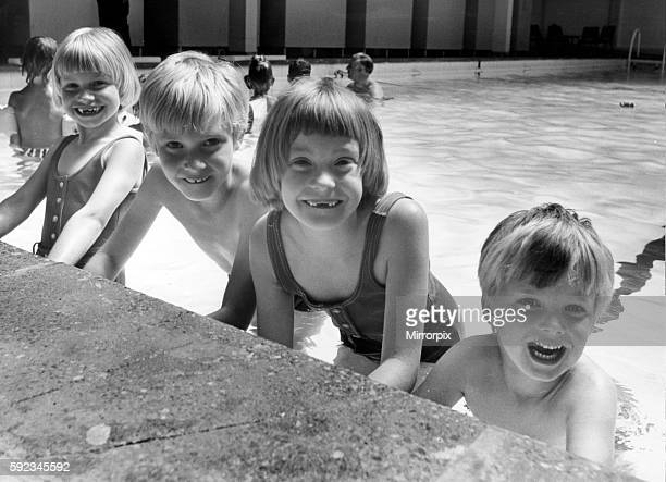 The three surviving Thorns sextuplets with their younger brother David at the swimming baths they are Susan Roger Julie all 7 years old with David...