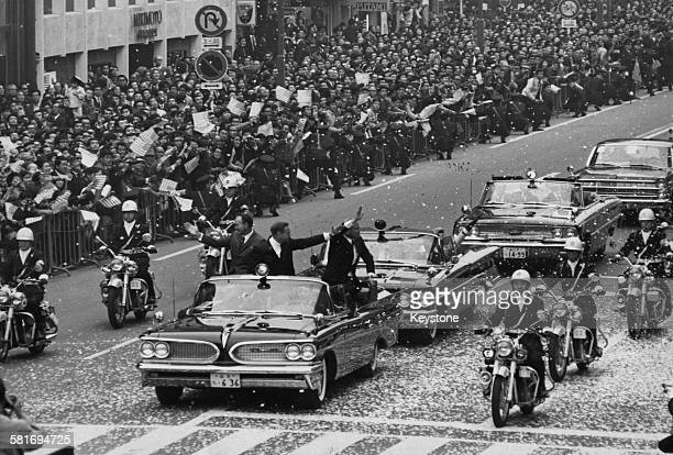 The three US astronauts from the Apollo 11 mission take part in a tickertape parade in the Ginza Tokyo during a twoday visit to Japan on their...