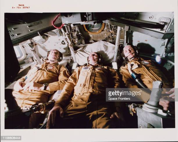 The three US prime crewmen of the ApolloSoyuz Test Project lying in their couches in the Apollo Command Module trainer in Building 35 of NASA's...