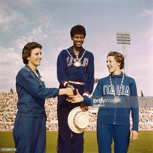The three winners of the women's 100 meters received their medals, standing on victory podium. First Wilma Rudolph of U.S.A., Second Dorothy Hyman of...