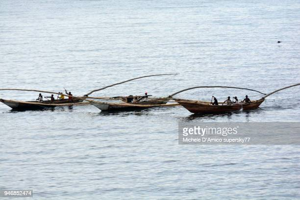 the three-hulled fishing boat typical on lake kivu - dugout canoe stock photos and pictures