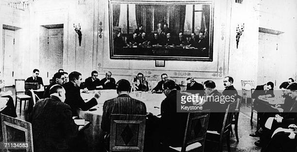 The threepower conference in session in Moscow with representatives from Britain America and Russia October 1943 Anthony Eden leans forward to...