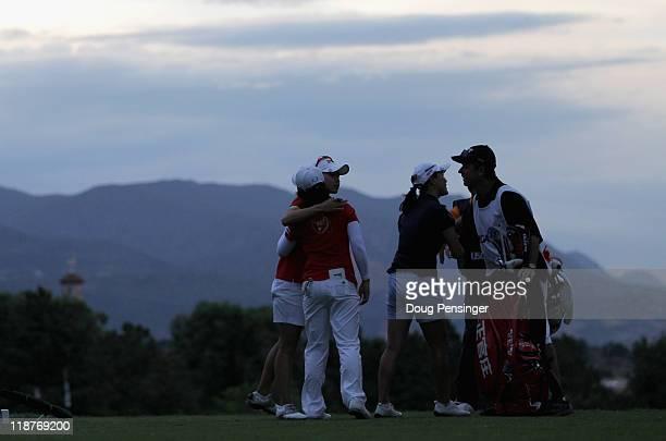 The threesome Sun Young Yoo EunHee Ji and So Yeon Ryu all of Korea and Ji's caddie Adam Woodward bid adieu on the 16t tee box as play was suspended...