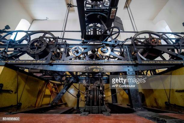 The three-train clock, known as the Great Clock, which drives the hands, hourly chimes, and the quarter-hourly chimes of the bells, including the...