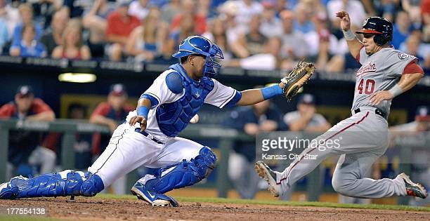 The throw to the plate gets past Kansas City Royals catcher Salvador Perez allowing Washington Nationals' Wilson Ramos to score in the seventh inning...