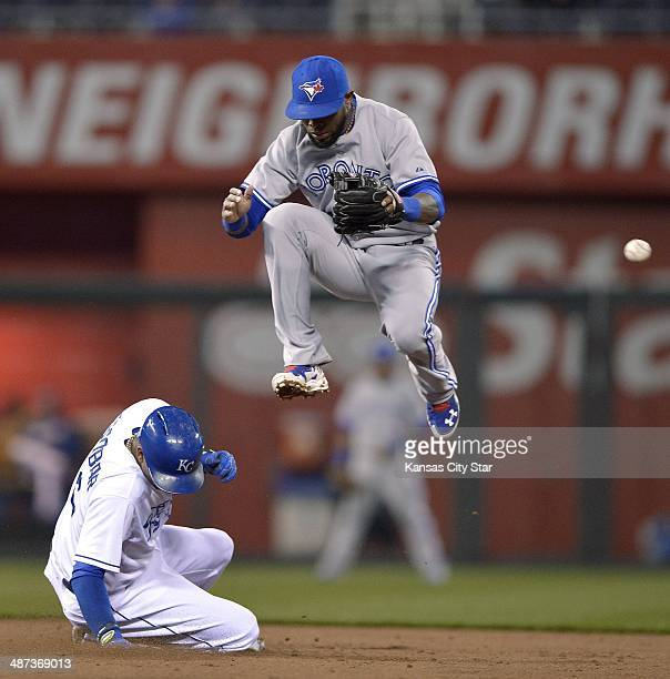 The throw to Toronto Blue Jays shortstop Jose Reyes right skips past him on a steal by the Kansas City Royals' Alcides Escobar that allowed Alex...