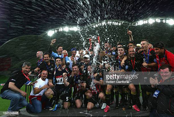 The Thunder celebrate after they won the VPL Grand Final between the Dandenong Thunder and Oakleigh Cannons at AAMI Park on October 14 2012 in...