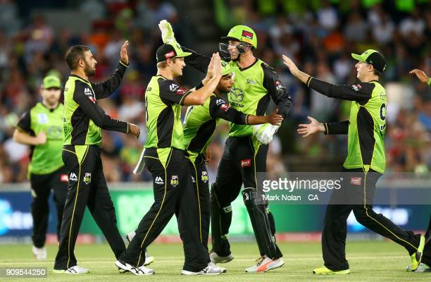 The Thunder celebrate the run out of Tom Cooper of the Renegades during the Big Bash League match between the Sydney Thunder and the Melbourne...
