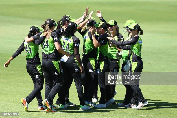The Thunder celebrate the wicket of Elyse Villani of the Scorchers during the Women's Big Bash League match between the Perth Scorchers and the...