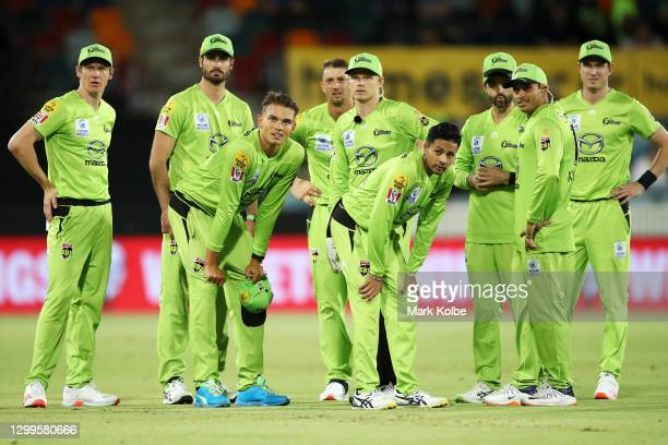 The Thunder watch the big screen as they wait for the decision after the run out of Marnus Labuschagne of the Heat by Chris Green of the Thunder...