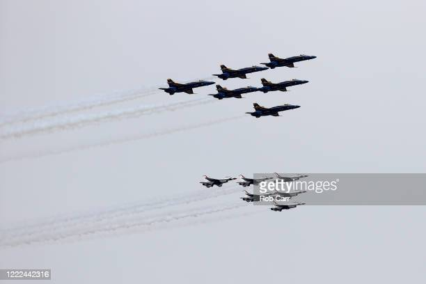 The Thunderbirds and Blue Angels preform a flyover on May 02 2020 in Baltimore Maryland The Blue Angels and Thunderbirds took to the sky to pay...