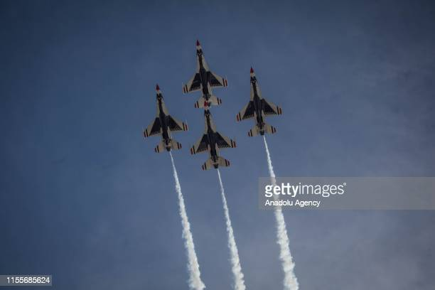 The Thunderbirds EEUU air force combat command unit made up of 8 pilots on board F16 Fighting Falcon aircraft during a perform at International Air...