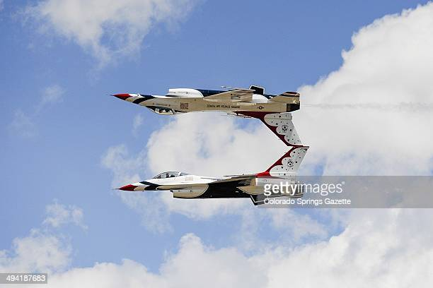 The Thunderbirds perform an aerial demonstration after the graduation ceremony for the United States Air Force Academy class of 2014 at Falcon...
