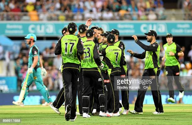 The Thunders players celebrate after taking the wicket of Chris Lynn of the Heat during the Big Bash League match between the Brisbane Heat and the...